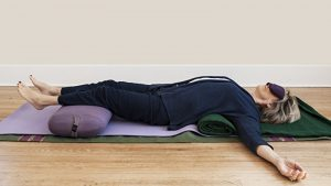Group yoga classes - restorative yoga, gentle yoga, meditation - restful supported yoga pose